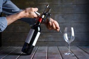 bigstock Male Hands Opening A Wine Bott 364663312