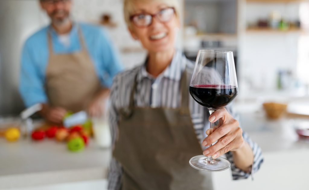 Woman Holding Red Wine Glass on Valentine's Day